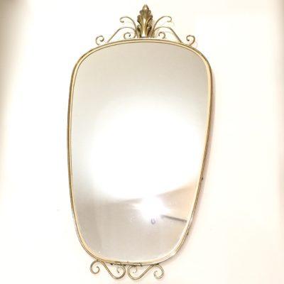 Miroir doré et orné