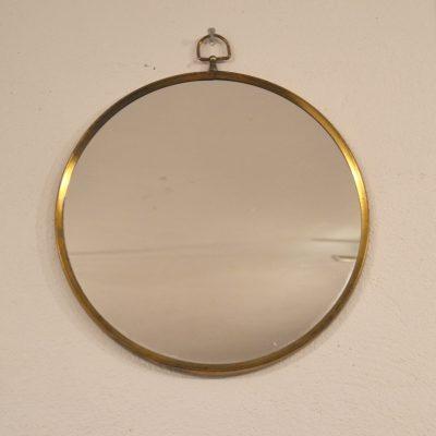 Miroir rond cerclé de laiton