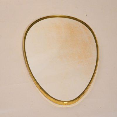 Petit miroir doré de forme libre