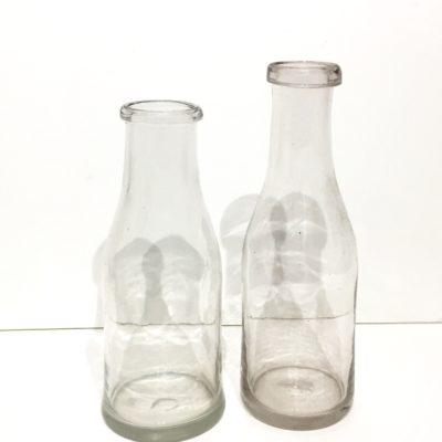 Bouteilles de lait anciennes en verre